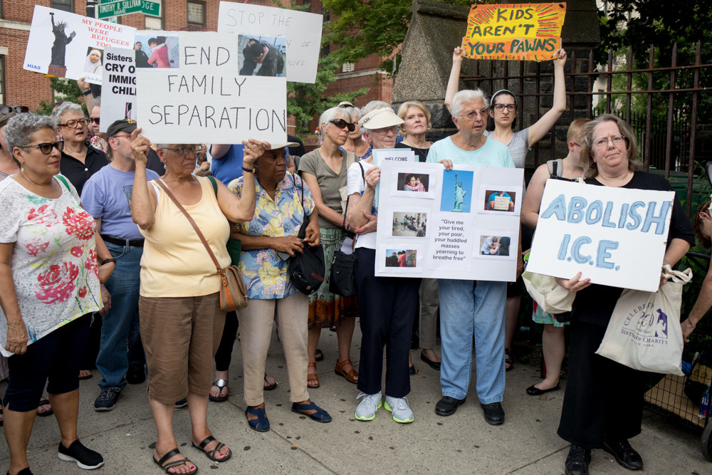 A protest on the corner of West 231st Street and Kingsbridge Avenue drew dozens of people to rally against the family separation tactic that border patrol agents use against undocumented families seeking asylum.