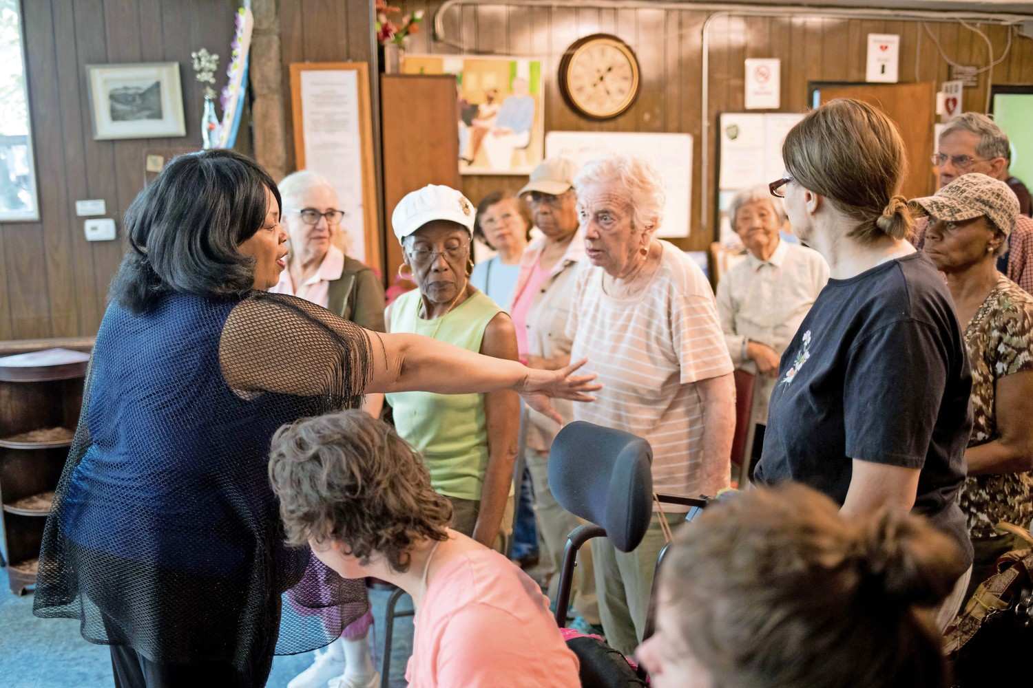Cheryl Warfield directs her students where to stand when they sing. Warfield has been teaching senior citizens at the JASA Van Cortlandt Senior Center how to sing, and will lead them in a performance on Independence Day.