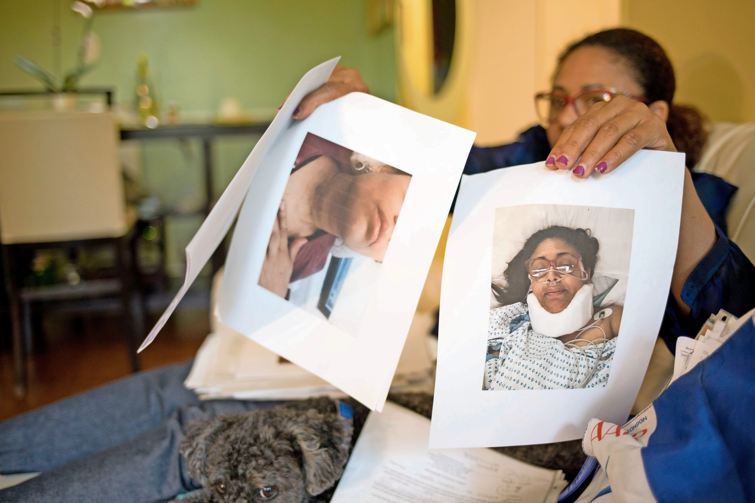 Claudia Imbert, a public school teacher, holds up photos of herself after she was hit by a car last year. After she finished teaching an at-home student, Imbert walked to her car when she was hit by a driver. The United Federation of Teachers denied Imbert her line of duty injury case, so she is suing.