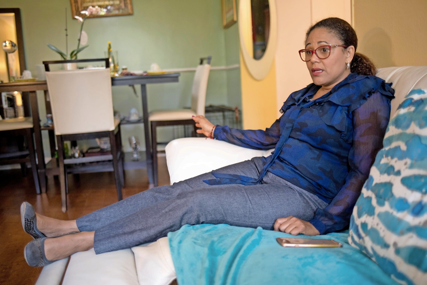 Claudia Imbert has to sit with her legs raised following an accident last year in which she was hit by a car after leaving a student's home. A public school teacher, Imbert is suing the United Federation of Teachers because they denied her line of duty injury case.