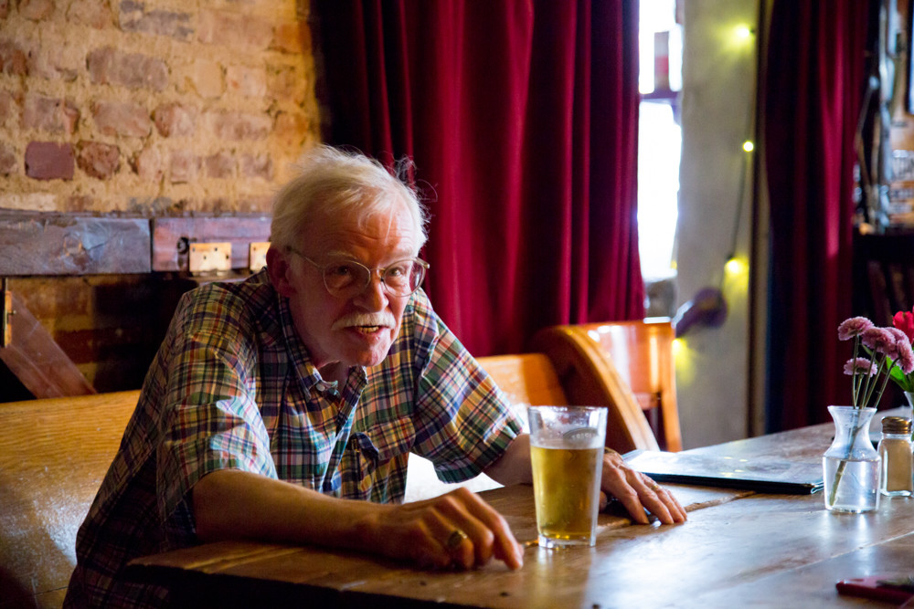 Bill Lewis, a volunteer with the Riverdale-Yonkers Society for Ethical Culture, sits with a pint of beer ahead of the organization's monthly 'Ethics on Tap' event at An Beal Bocht Café.