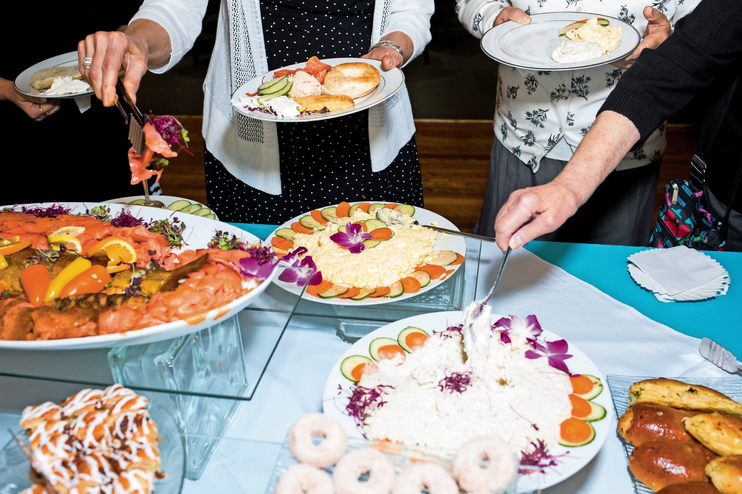Attendees of the Bronx Jewish Community Center's annual 'Breakfast of Champions' fill their plates after an awards ceremony at the Riverdale Jewish Center.