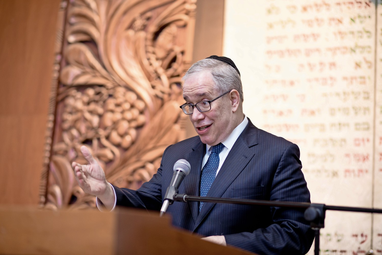 New York City comptroller Scott Stringer introduces an award for Michael Spicer, the chief executive officer of St. Joseph's Medical Center, during an awards ceremony for the Bronx Jewish Community Center's annual 'Breakfast of Champions.'