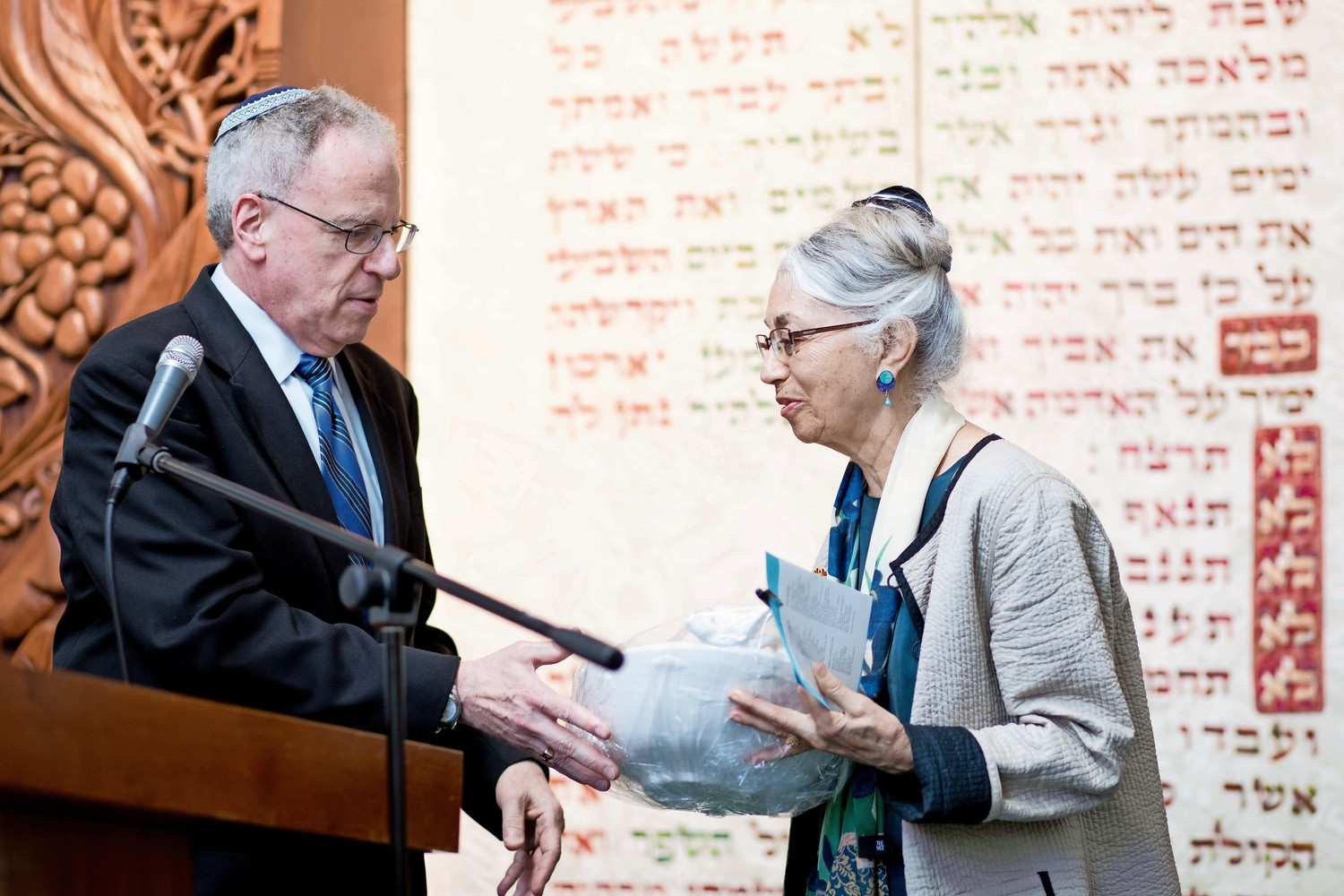 Assemblyman Jeffrey Dinowitz hands an award to Ruth Rosenblatt, a doctor, during an awards ceremony at the Bronx Jewish Community Center's annual 'Breakfast of Champions.'