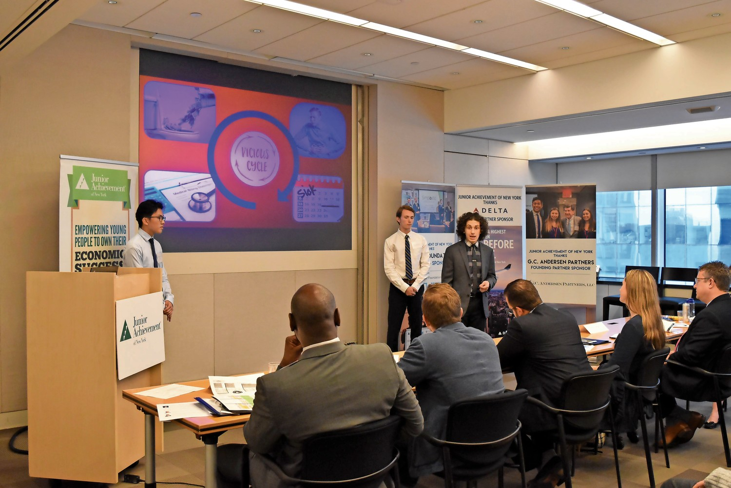 Bronx Science students Seungwon Hyun, Dvir Avnon-Klein, center, and James Snyder present their business idea for a biosensor that could detect contaminants in meat. They won first place.
