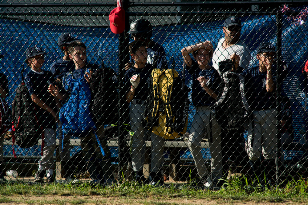 The Yankees watch one of their teammates at bat against the Nationals during Game 3 of the North Riverdale Baseball League's major boys championship tournament. The Nationals beat the Yankees 7-5 to take the title.