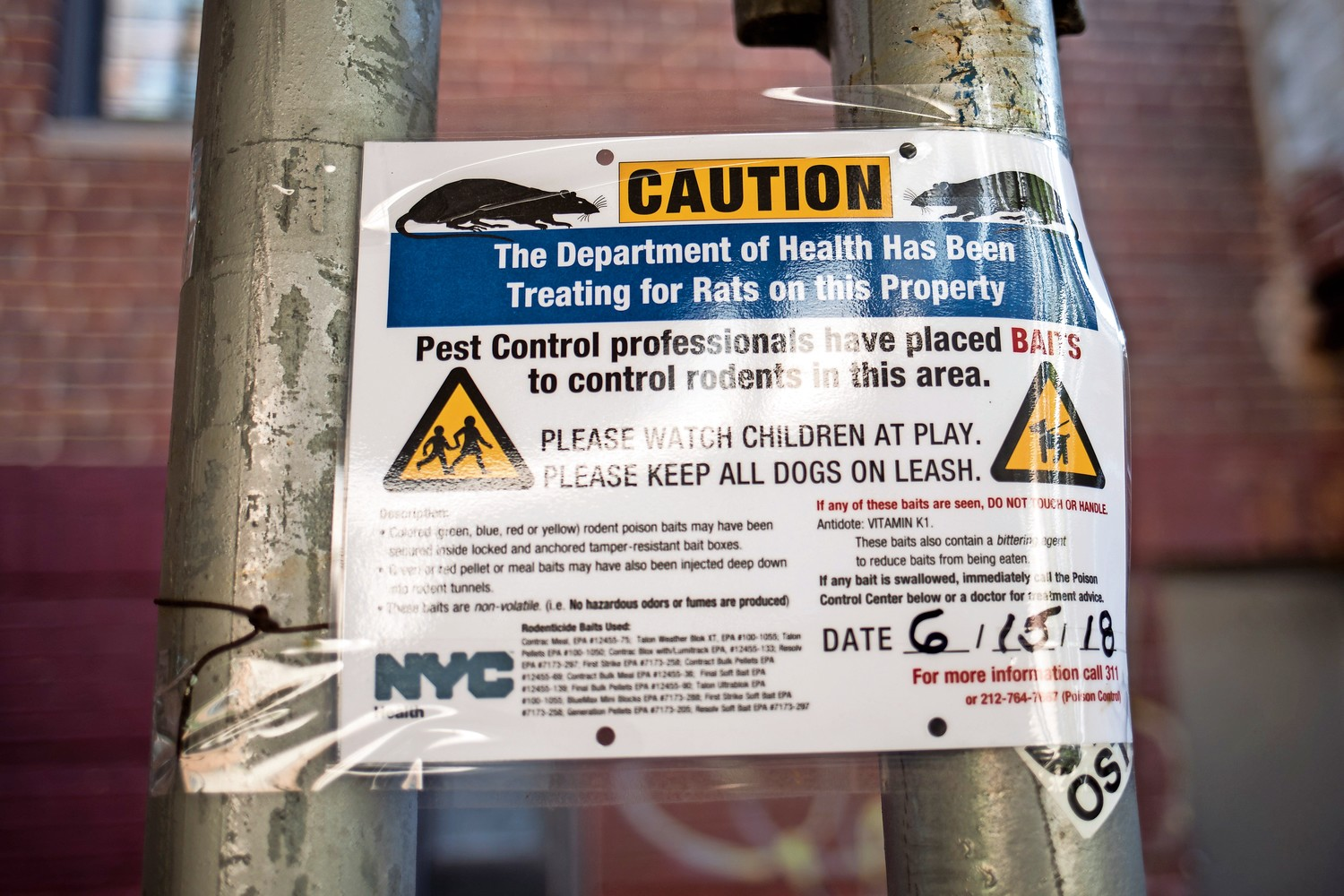 A sign warns residents that baits have been placed in the area to trap and kill rats, which have recently flocked to the step street connecting Waldo and Irwin avenues at West 238th Street.