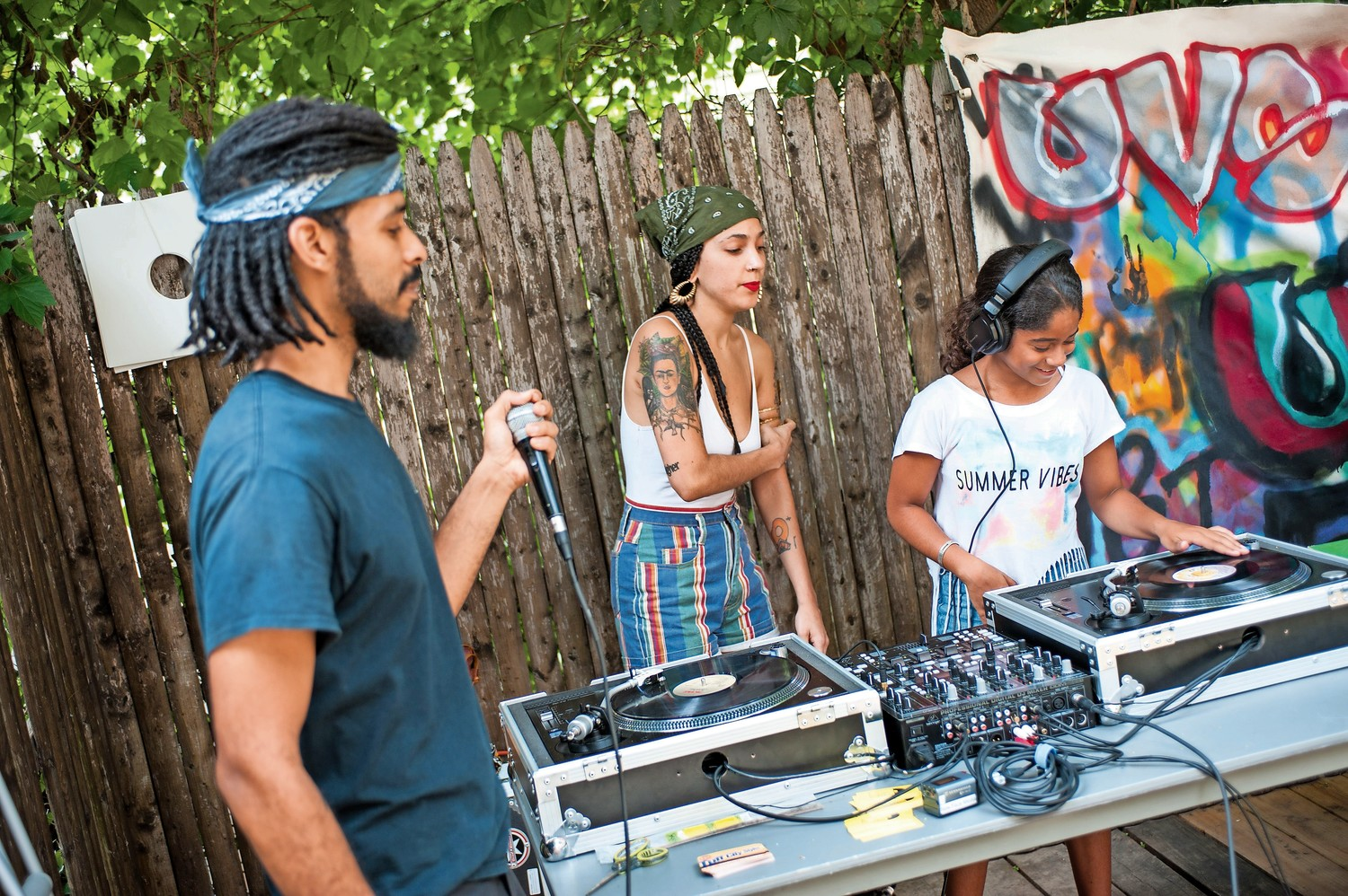 Arleen 'DJ A-Aron' Ramos, takes a turn and spins and scratches on the turntables at the summer jam on the last day of Hip-Hop Summer School at the Kingsbridge Heights Community Center. She is one of the students who took in the summer course, learning more about the art form.