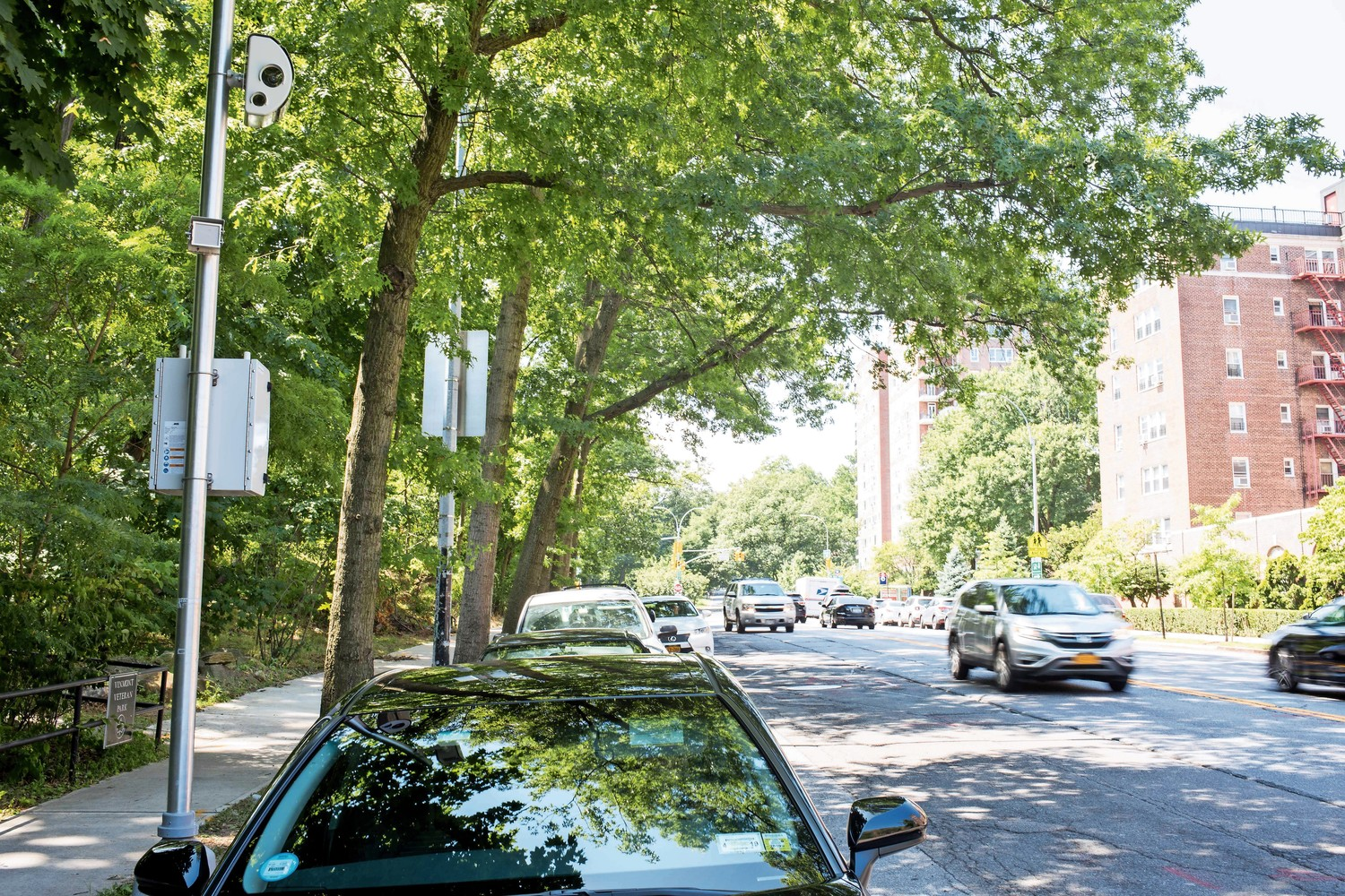 Cars drive past a speed camera on Riverdale Avenue between West 256th and West 259th streets near P.S. 81. The speed camera program is set to expire on July 21, which residents and local lawmakers feel is a mistake.