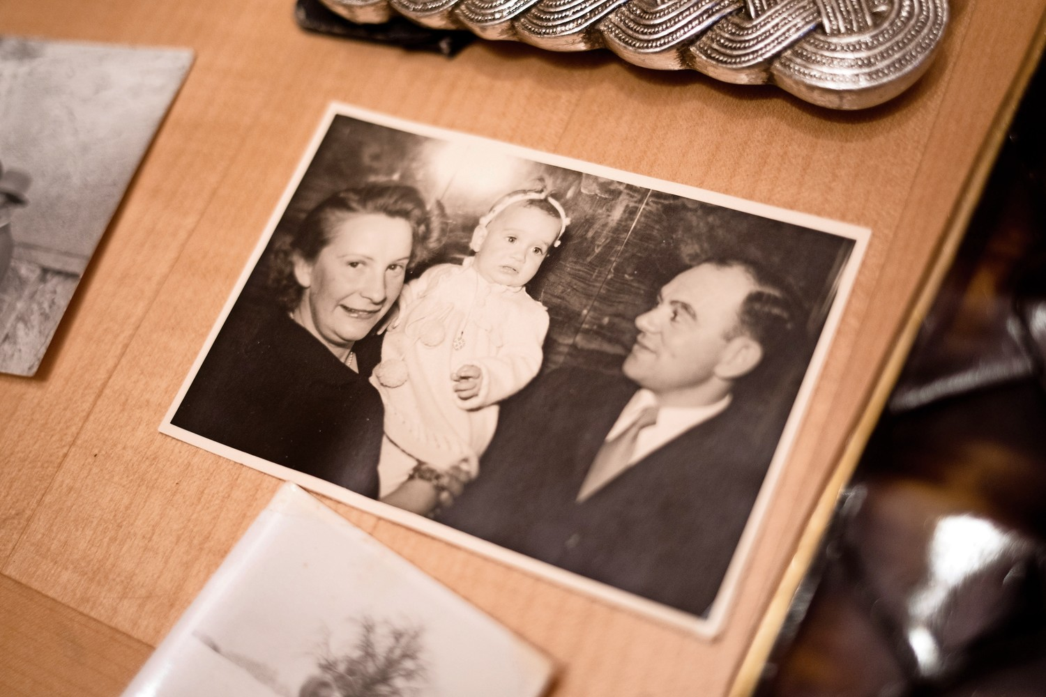 A 1950 photograph shows a newborn Helene Kamioner with her mother and father, Chava and Yechiel. Helene Kamioner remembers her parents fondly, and recently learned that the Yad Vashem, Israel's Holocaust memorial, found her father's dog tag with his prisoner number on it. He spent six years in a labor camp during World War II.