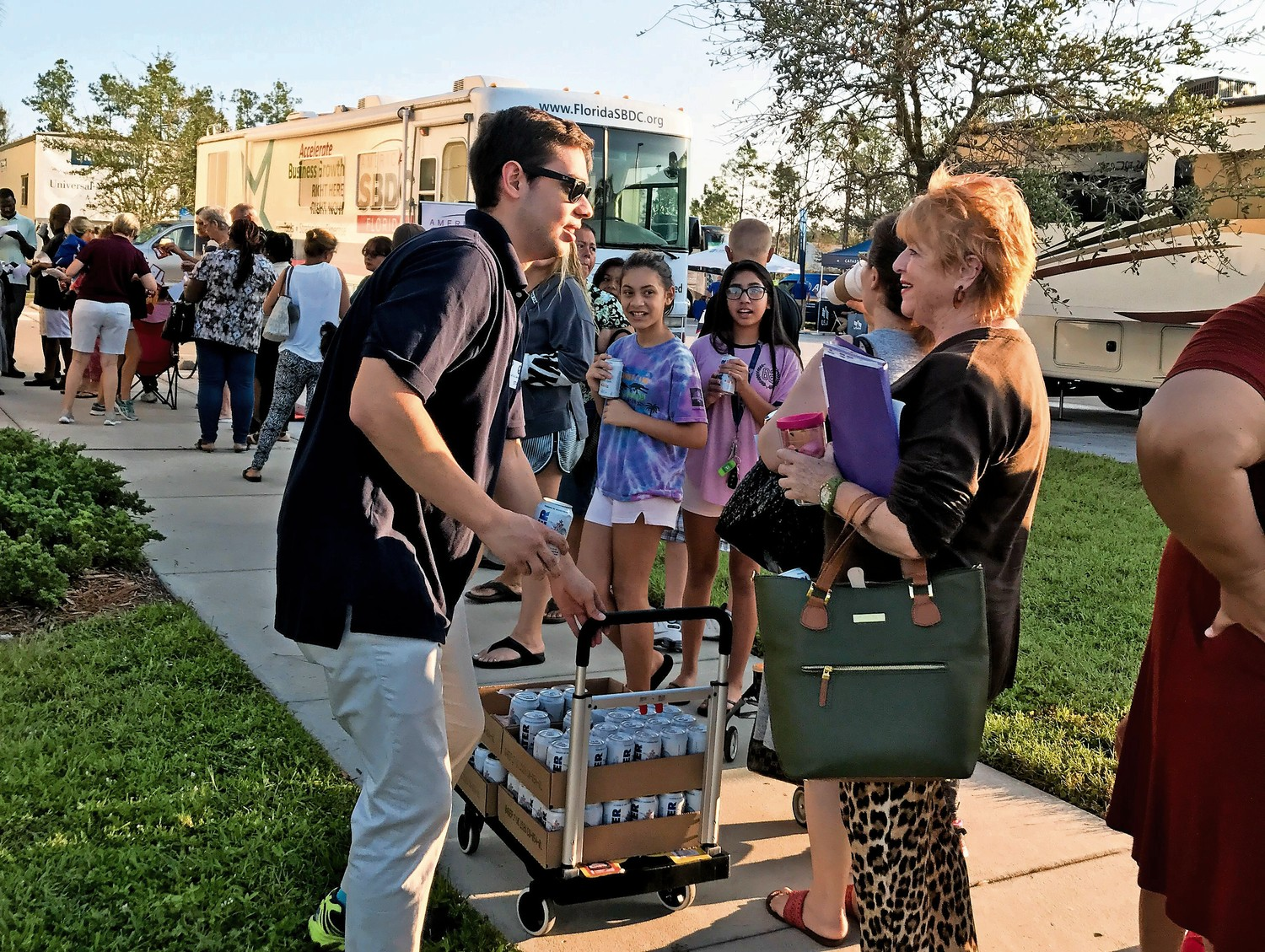 Anthony Cruz distributes cans of water during a hurricane recovery operation in Florida in September last year. Cruz is the deputy press secretary for U.S. Sen. Marco Rubio, and is a graduate of the David A. Stein Riverdale/Kingsbridge Academy.