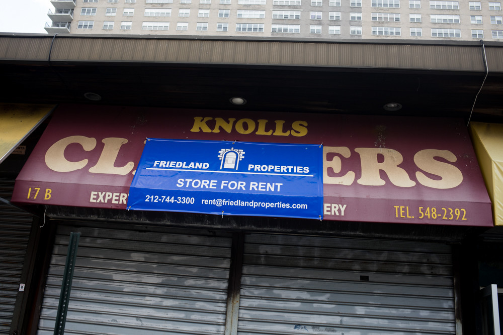 A sign for billionaire Lawrence Friedland's company Friendland Properties partially covers the awning of the long-defunct Knolls Cleaners in Spuyten Duyvil. Along the same sleepy strip, Kappock Cafe and Wine Bar, also in a Friedland-owned storefront, is the latest to shutter, to the dismay of neighboring business owners.