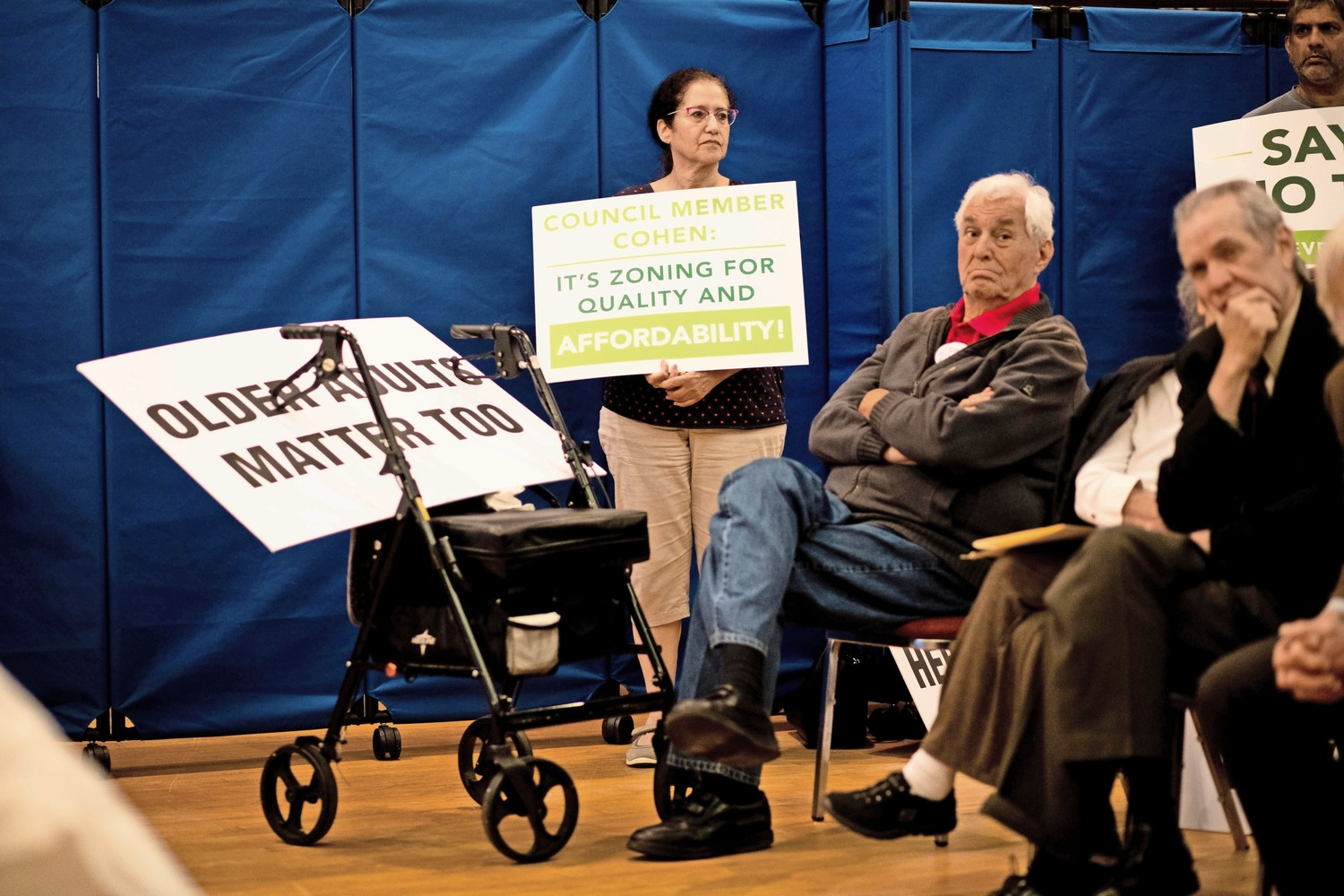 Supporters and opponents of the Hebrew Home at Riverdale's plans to build a continuing care retirement community attend a public comment session at the Riverdale Temple. CB8 had to pay $1,300 to host their four-hour meeting at the temple.