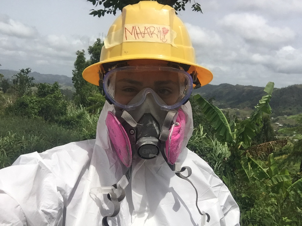 In some instances, Lehman College student Mharielys Rodriguez had to wear full protective gear while working on a house in Puerto Rico with fellow CUNY students as part of a hurricane relief effort there. While Rodriguez and other volunteers offered hope, they saw firsthand through the residents there was still a lot of work to be done.