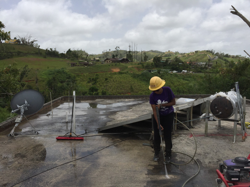 Mharielys Rodriguez, a student at Lehman College, traveled to Puerto Rico with a classmate to help with relief efforts there. Part of the cleanup involved power washing the roof of a house. Rodriguez used to live in Puerto Rico, so when she was given the chance to volunteer with the 'NY Stands with Puerto Rico' recovery and rebuilding effort, she says she was happy to do so.