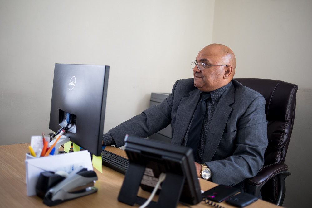Alltown Car Service president Hector Diaz works on his office computer in his office on Kingsbridge Avenue, near the company's West 231st Street location. Before moving to America, Diaz worked for cab companies in his native Dominican Republic.
