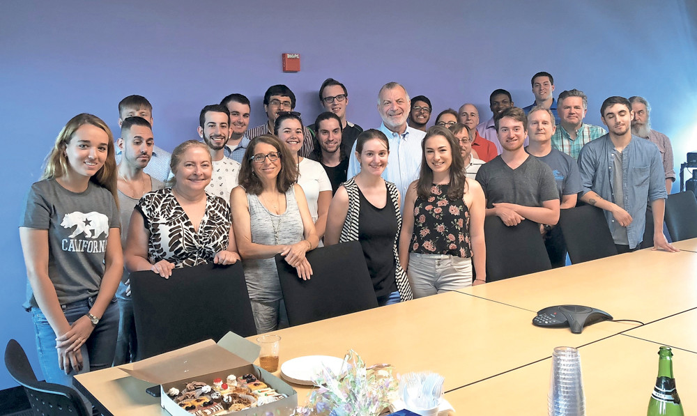 Longtime publisher Cliff Richner, at right, poses one last time with some members of the Long Island editorial staff to celebrate his retirement after 36 years in the business. He remains an owner of the company founded by his parents, that also owns The Riverdale Press.
