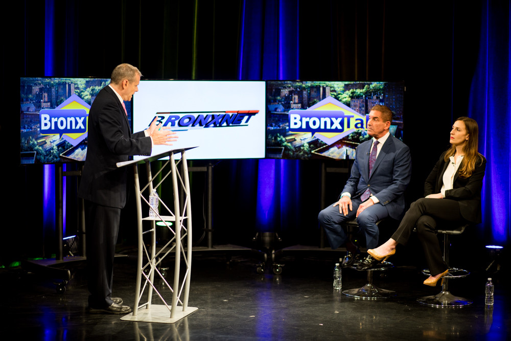 Gary Axelbank moderates a debate between state Sen. Jeffrey Klein and Democratic primary challenger Alessandra Biaggi earlier this summer. Axelbank will anchor live election coverage on BronxNet on Thursday night.