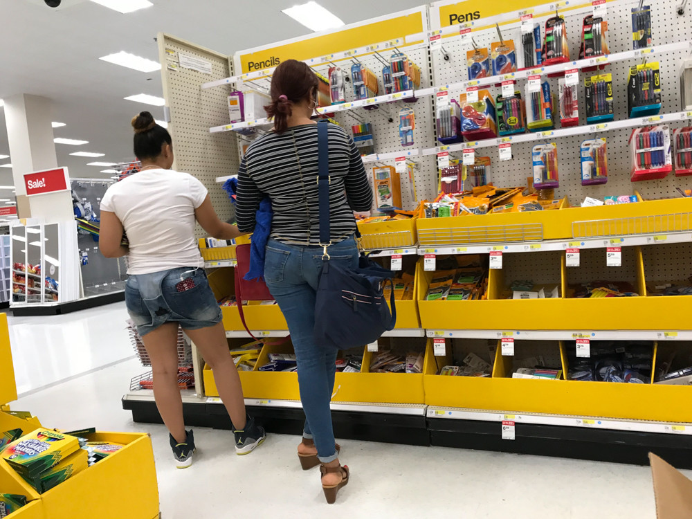 Customers look through school supplies at Target. A number of schools, including Riverdale/Kingsbridge Academy and P.S. 95 Sheila Mencher have partnered with Teacher Lists, an online service that provides a list of any given school's supplies, which parents can find at participating retailers.