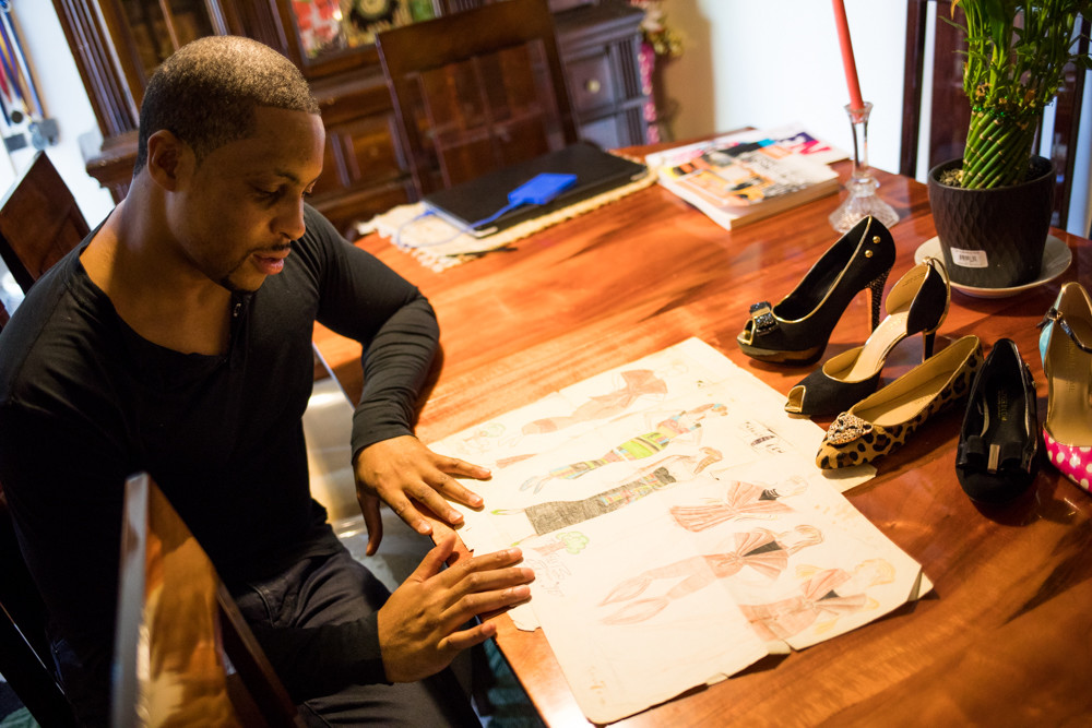 Sherwayne Mahoney looks at the designs he drew for his fashion illustration class at John F. Kennedy Campus, which proved to be pivotal in him ultimately deciding to pursue fashion. Mahoney is the founder of the luxury fashion label Things II Come, which boasts a line of jewelry and high-end shoes.