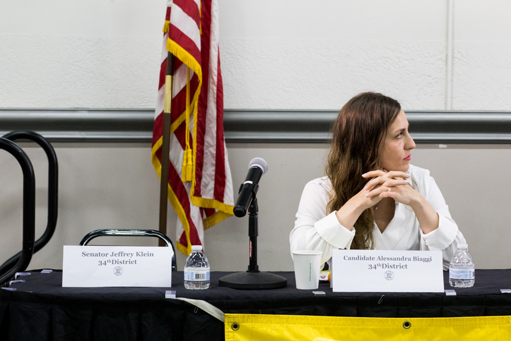 Alessandra Biaggi sits on the panel at a nonpartisan candidates forum held by the Northwest Bronx Community and Clergy Coalition on Aug. 22 next to a seat reserved for state Sen. Jeffrey Klein, who didn't attend.