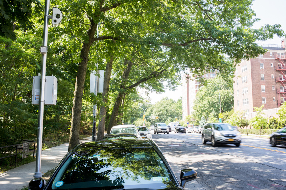 Cars drive past a speed camera on Riverdale Avenue between West 256th and West 259th streets near P.S. 81. The speed camera program was set to expire July 25, but Gov. Andrew Cuomo and the New York city council restored the cameras through an executive order.