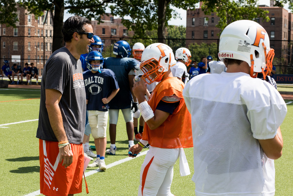 Fieldston head coach Gus Ornstein confers with senior quarterback Jesse Cooper-Leary during a recent preseason scrimmage versus Dalton.