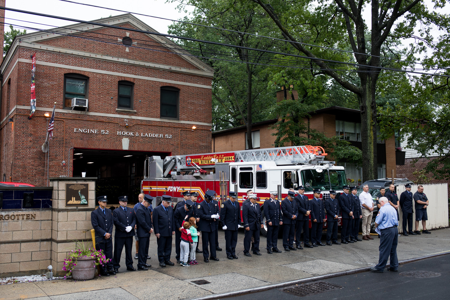 Firefighters with Ladder 52 stand for a moment of silence on the 17th anniversary of the lives lost on Sept. 11, 2001.
