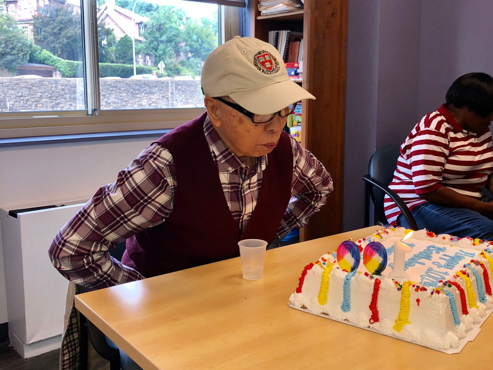 Ming Chin blows out the candle on his birthday cake at Riverdale Senior Services. Chin, who celebrated his 100th birthday Aug. 27, immigrated to the United States when he was 39. He then went on to get his master's in civil engineering from Harvard University.
