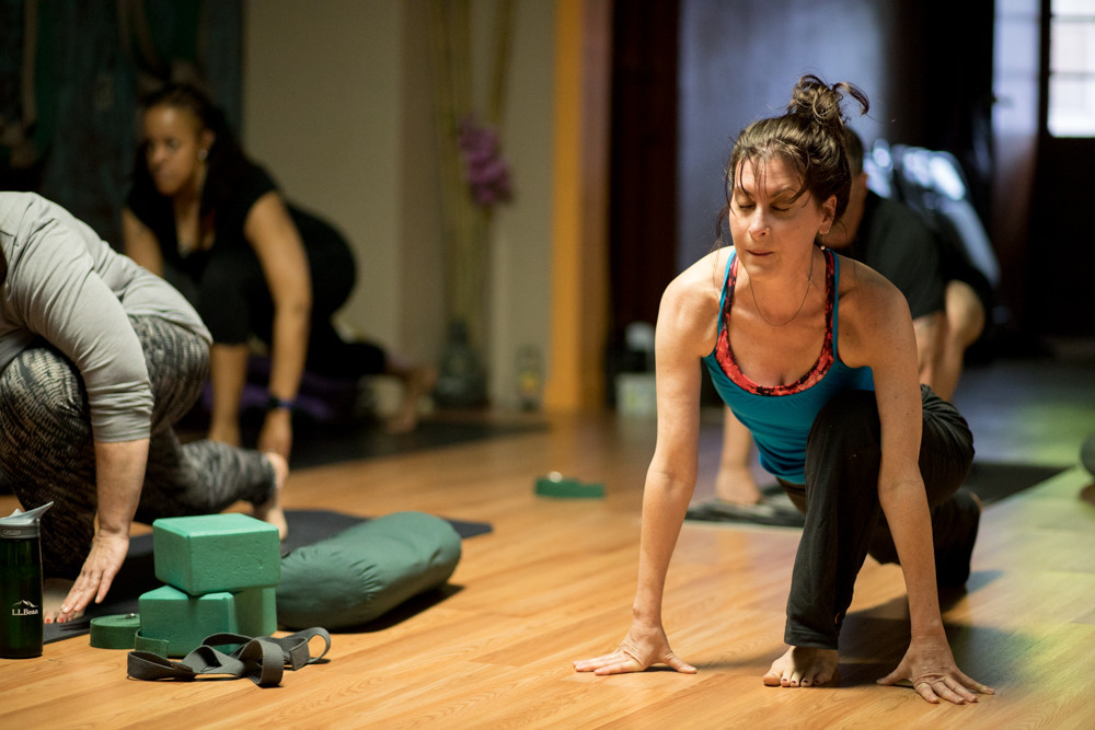 Ilana Davidson guides her students into a low lunge during a session at the Nueva Alma Yoga Studio in Yonkers. Davidson is a Grammy-winning soprano vocalist who has been practicing yoga for 20 years, in addition to her vocal career.