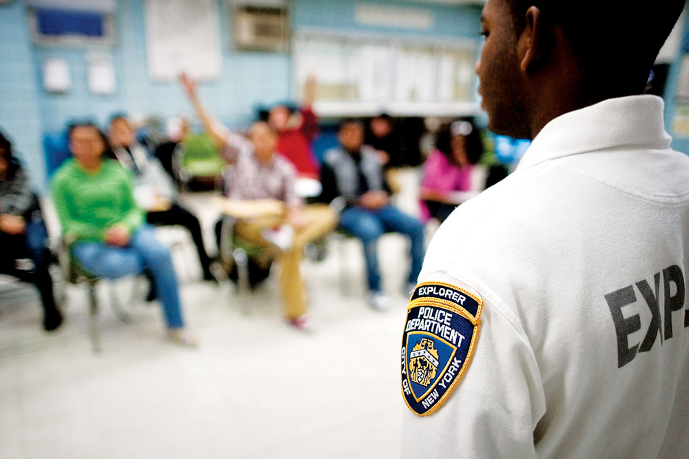 Former police Explorer Jorge Guerrero leads high schoolers in search and recover scenarios during a meeting of the Police Explorers program in 2010. Explorers are taught leadership skills and are mentored by the officers in the 50th Precinct.