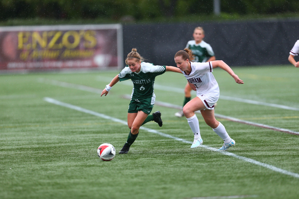 Manhattan senior Annie Doerr (6) works her way past a Fordham defender in the Jaspers' 2-0 loss to the Rams in the Battle of the Bronx.