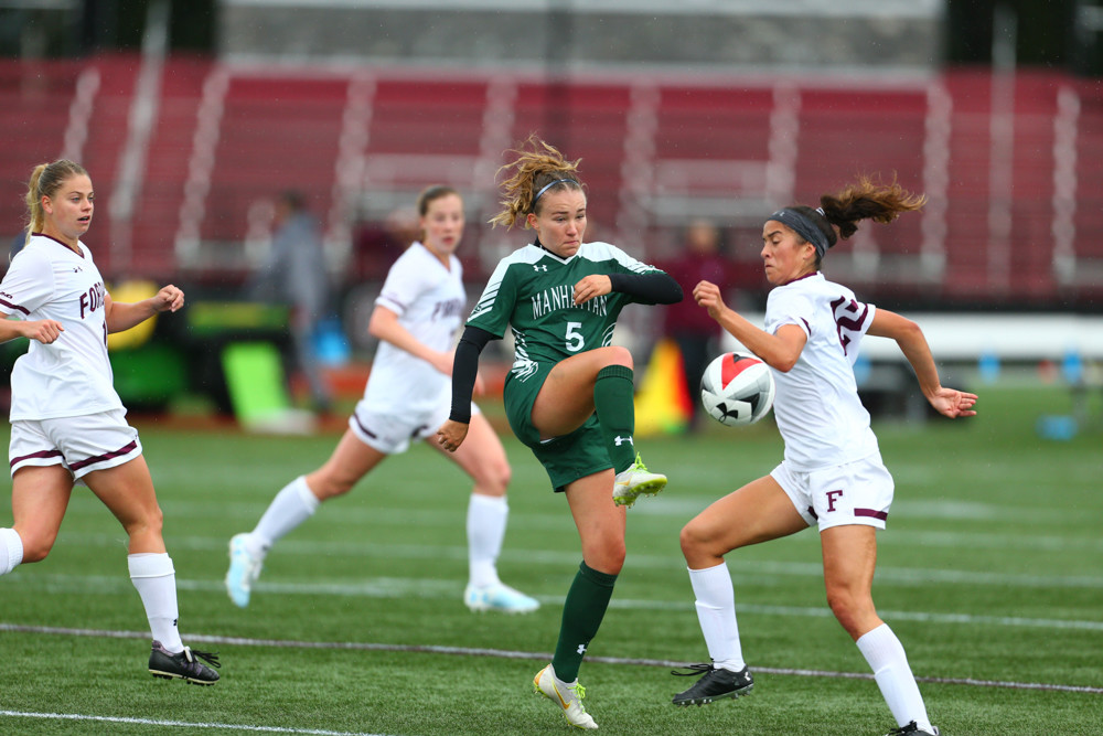 Manhattan's Tia Painilainen (5), a sophomore midfielder who hails from Finland, finds herself surrounded by Fordham defenders in last week's 2-0 loss to the Rams.