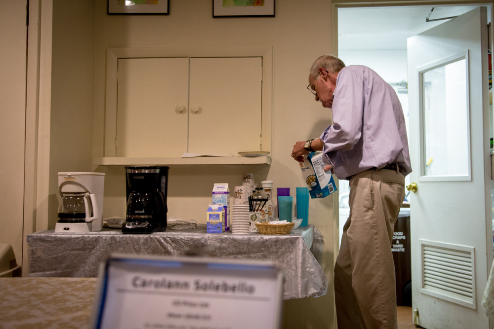 An attendee of a Coffee House event at the Riverdale-Yonkers Society for Ethical Culture fixes a cup of coffee with almond milk. The Sept. 9 event featured performances by DK & the Joy Machine, Lindsey Wilson and Carolann Solebello.