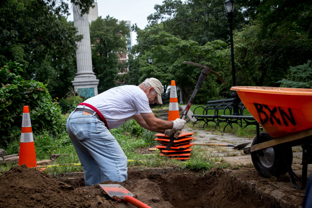 Mark Mason, a co-founder of the Stewards of Henry Hudson Park, works to clear a plant bed.