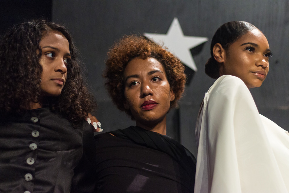 Models stand for photos during Edwin Reyes's latest fashion show Sept. 14 at The Point. The show was in honor of Puerto Rico and was used to raise money for relief efforts in partnership with Siempre Contigo.