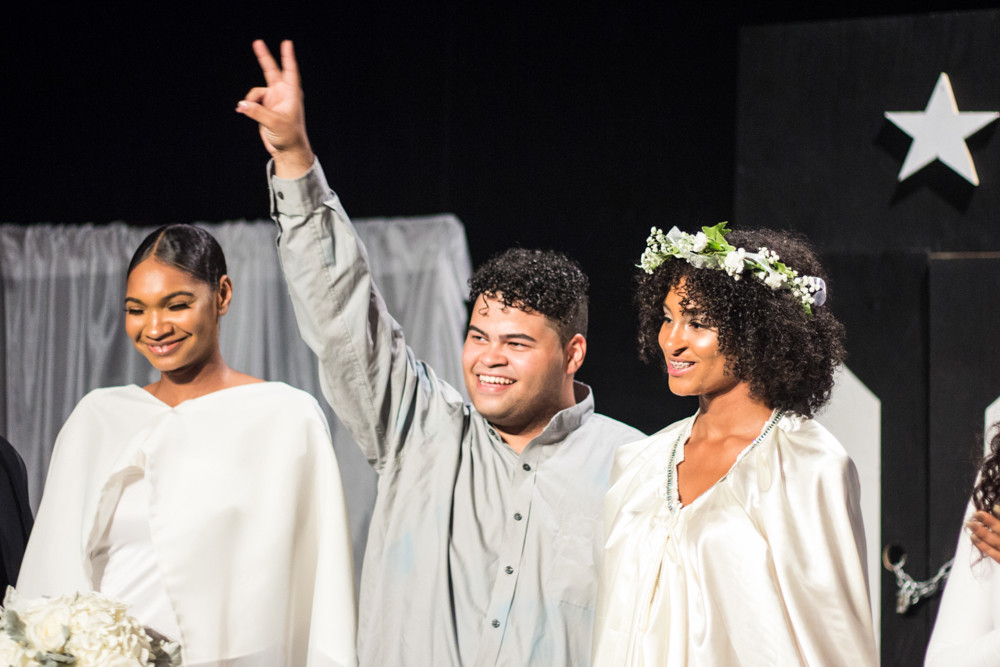 Fashion designer Edwin Reyes rejoices at the close of his third fashion show at The Point on Sept. 14. Reyes, 19, partnered with a non-profit to donate proceeds from the show to the ongoing relief efforts in Puerto Rico.