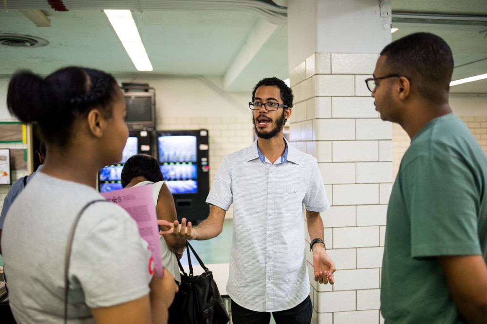 Raymundo Alvarez, a Bronx High School of Science alum, talks about his alma mater at the first-ever Spanish-language high school resource fair for students looking to apply to specialized high schools.