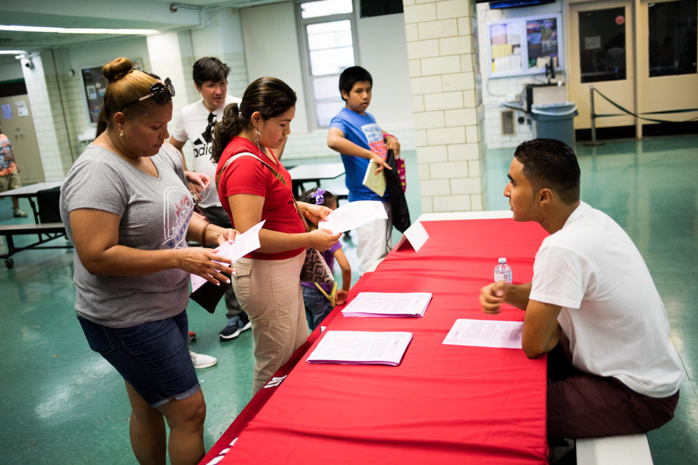 Families attend a Spanish-language high school resource fair at Bronx High School of Science. Schools chancellor Richard Carranza helped spearhead the effort in a push for greater diversity across specialized high schools.