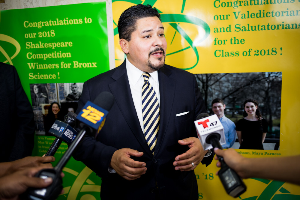 Schools chancellor Richard Carranza responds to questions from the media following a Spanish-language information session for students and families preparing to apply for admission to specialized high schools.