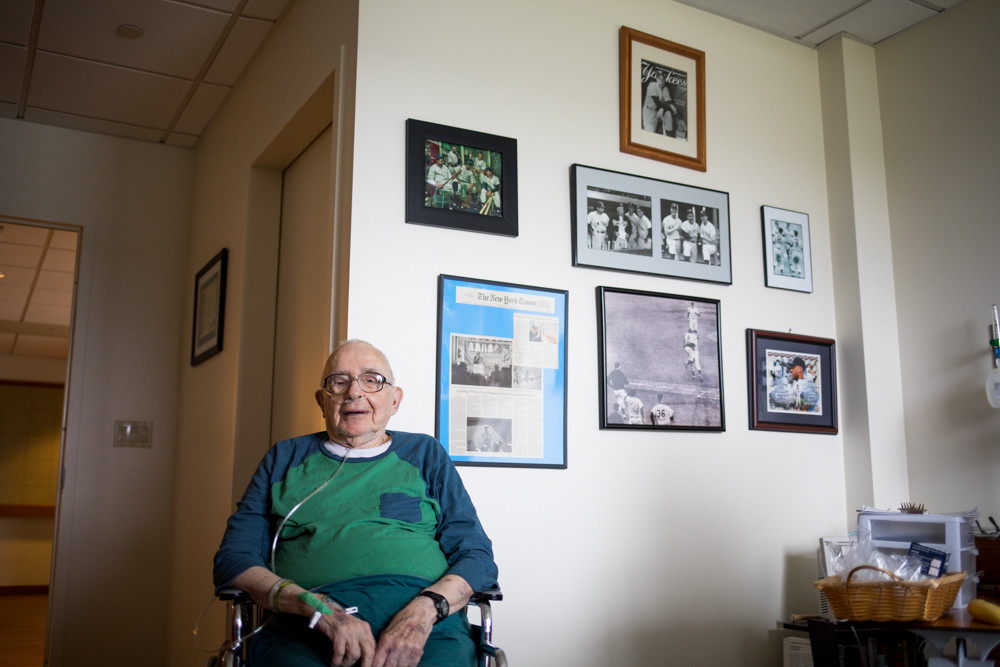 Alfred Schwartz has decorated his wall at the Hebrew Home at Riverdale with pictures of the New York Yankees. A World War II veteran, Schwartz was honored during an Aug. 28 game at Yankee Stadium.