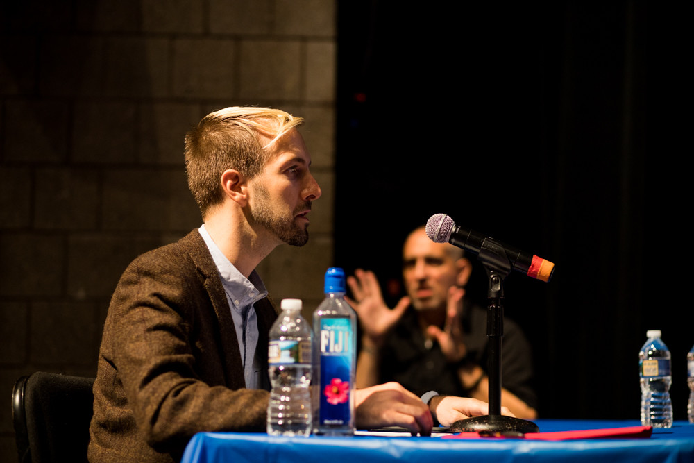 Jed Holtz, a political organizer for the Freedom Socialist party, asks the city council's charter review commission to consider giving non-citizens the right to vote at the first public comment session for the review of the city charter at Lehman College.