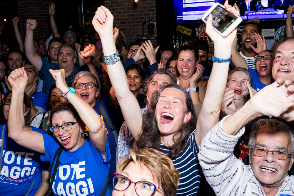 Supporters of Alessandra Biaggi cheer in the Bronx Alehouse in Kingsbridge as early election results show the insurgent progressive candidate gaining momentum against incumbent state Sen. Jeff Klein in the Sept. 13 primary race.