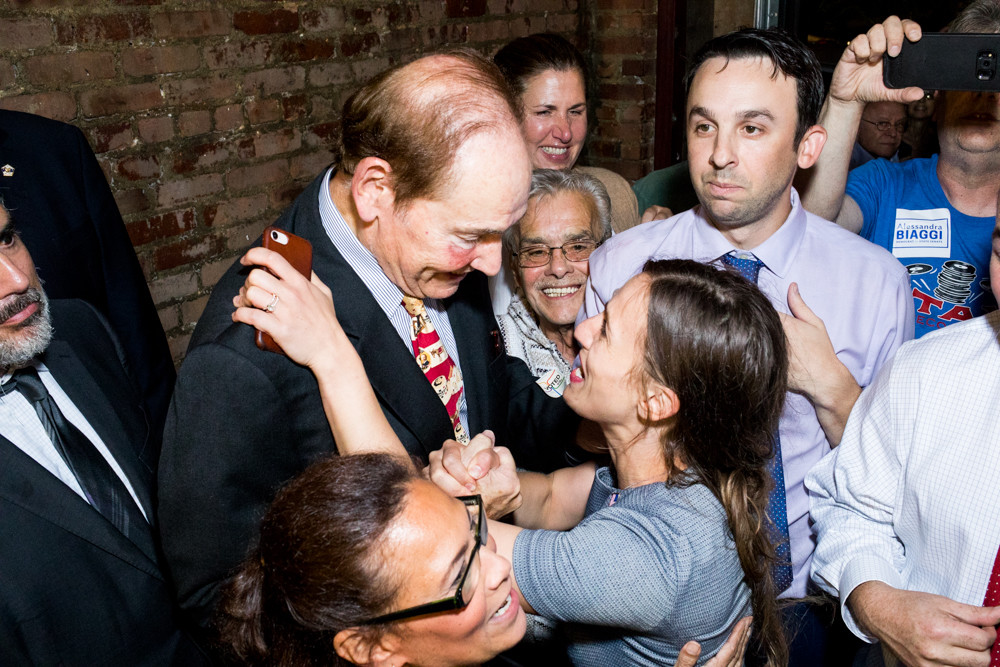 Alessandra Biaggi embraces former councilman Oliver Koppell at the Bronx Alehouse before giving a victory speech following her Sept. 13 Democratic primary defeat of state Sen. Jeffrey Klein, former leader of the now-defunct Independent Democratic Conference.