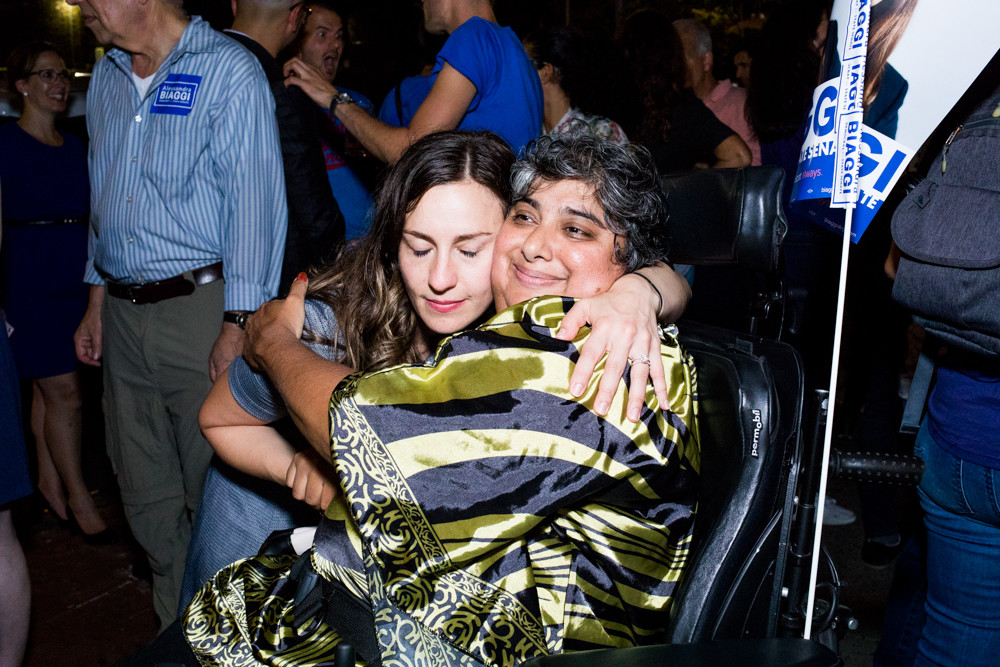 Alessandra Biaggi embraces a supporter during an election party at the Bronx Alehouse on West 238th Street after ousting state Sen. Jeffrey Klein in the Democratic primary last Thursday. 'If this does not prove that the political currency of this time is people over money, I don't know what does,' Biaggi said.