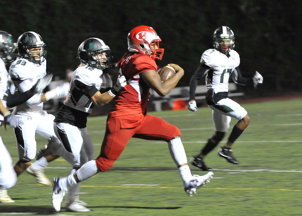 Kennedy sophomore running back Chris Boadi breaks off a big gainer in the Knights' 22-12 victory over New Utrecht.