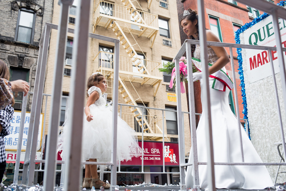 Marieteresa Porcher, 2018's Queen of the Feast for the Feast of San Gennaro, meets with a young princess and member of her court atop her float before the grand procession through Little Italy. Porcher is a Girl Scout from Riverdale, and is the first in her family to be Queen of the Feast.