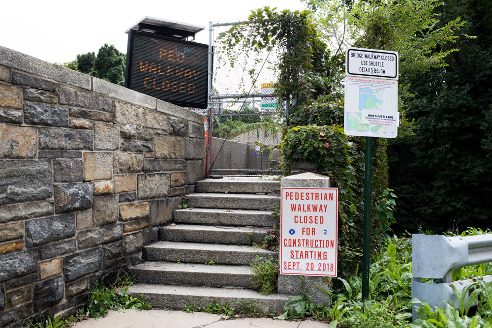 Signs posted at the entrance to the Henry Hudson Bridge's pedestrian pathway indicate the path is closed and where pedestrians can catch a shuttle to get across. Since the pathway's closure, the MTA has offered a daily shuttle that runs on the half-hour between 7 a.m. and 9 p.m. In the winter months, the shuttle will operate between 7 a.m. and 5 p.m.
