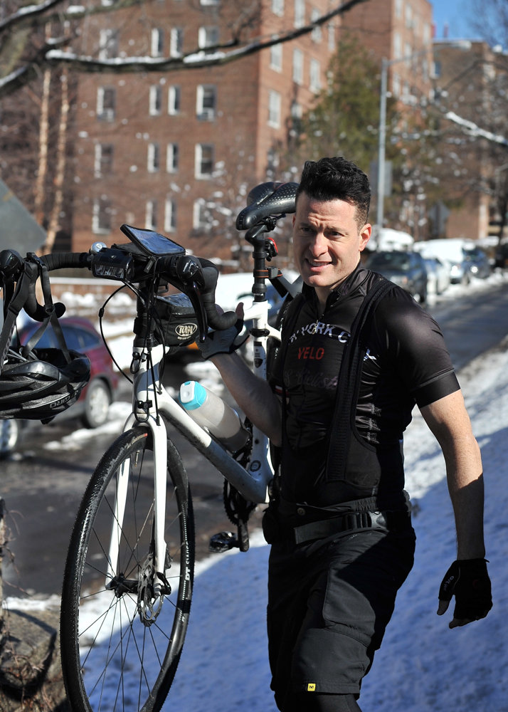 Craig Weingard carries his bicycle near the entrance to the pedestrian pathway on the Henry Hudson Bridge in February. Before the closure of the pathway, Weingard biked to and from work every day across the bridge. Now, Weingard has to detour to the Broadway bridge.
