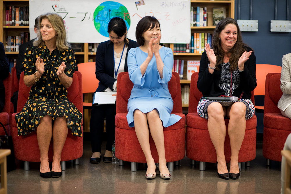 Japanese first lady Akie Abe, center, claps along with Caroline Kennedy, left, and Kirsten Larson, the principal of the Marble Hill School for International Studies, which has a robust Japanese language program and a cultural exchange program with Japan.